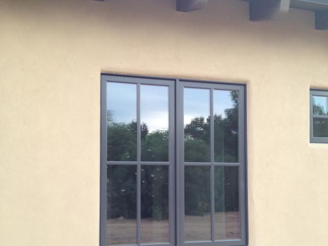 This first-floor window sits below the tile, mud-set roof.