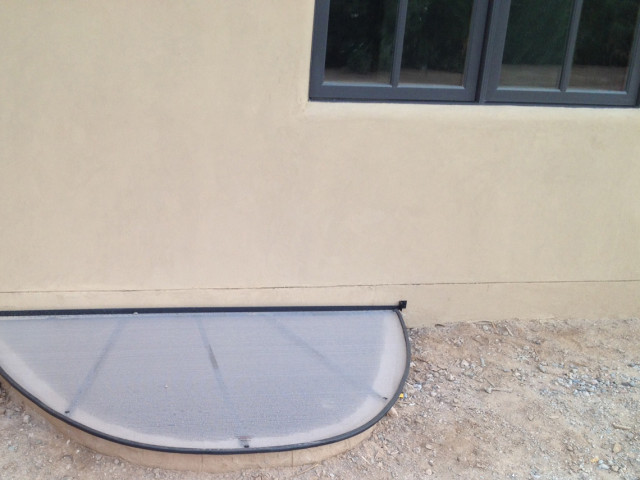 This cover protects the home's window well to the basement.