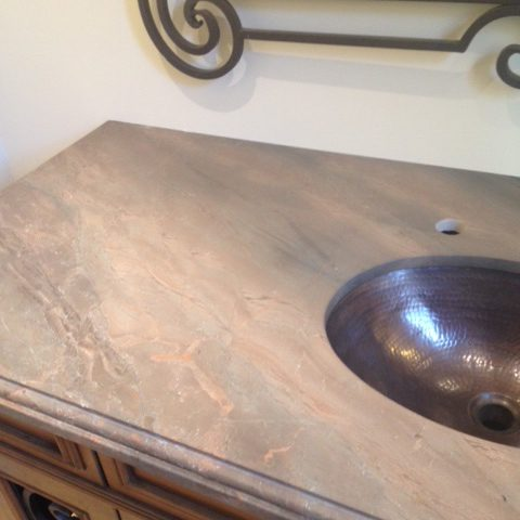 This granite top was hand selected by the client and matches the fireplace hearth