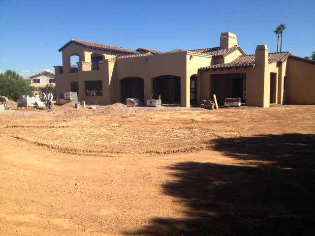 Rear view of the outside of the home before landscaping begins