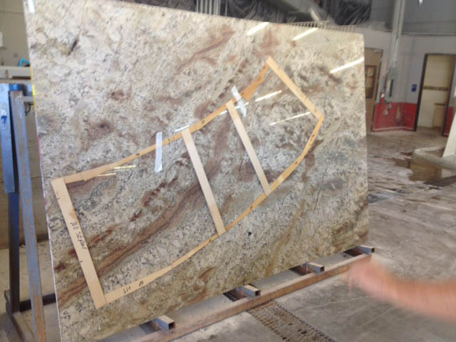 Granite company templating the slab that will become the BBQ counter top.
