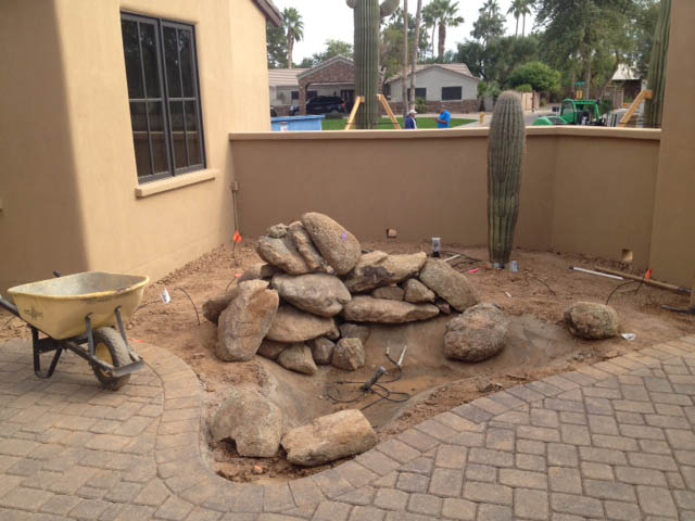 Beginning to build rock waterfall at the front courtyard
