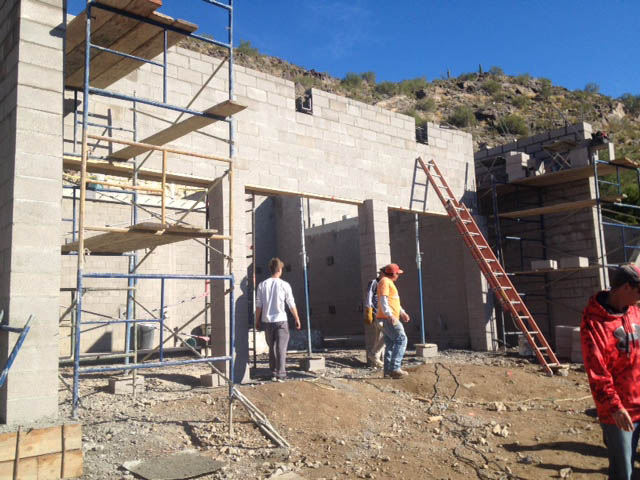 The garage walls are beginning to take shape at the lower level of the home.