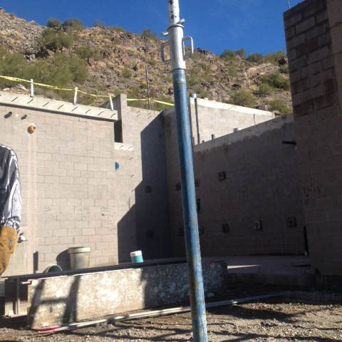 Masonry retaining walls are built with reinforcements to keep the integrity of the hillside structure.