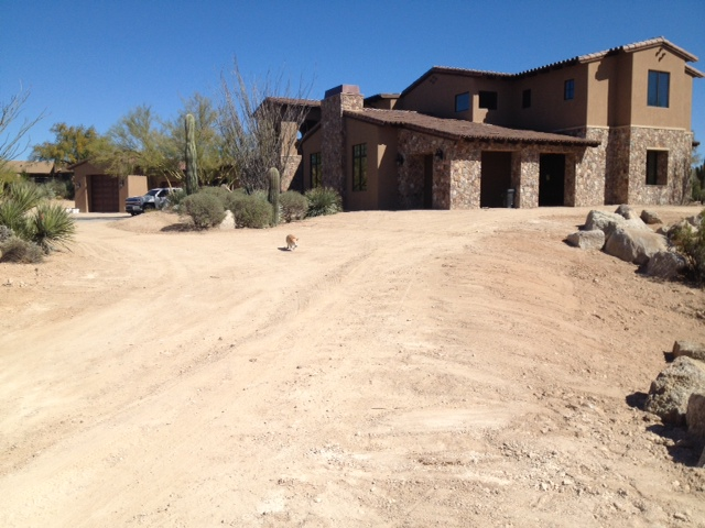 Nice long driveway has been graded and ready for pavers to be laid.