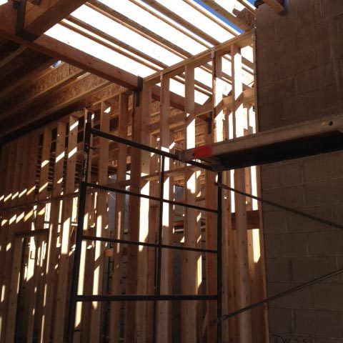 Walls are framed at the lower level motor court