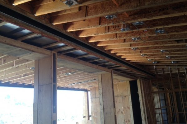 Above head mechanical shelves run along the ceiling.