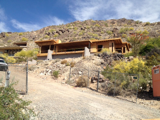 The view from the road shows the steep grade and how the home nestles into the mountainside.
