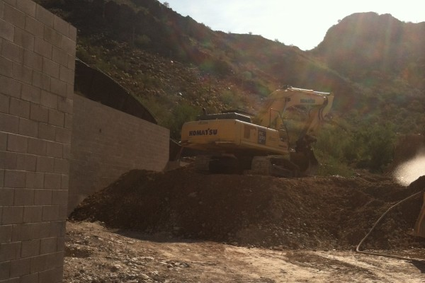 Large equipment is brought in to move earth and backfill the grading.