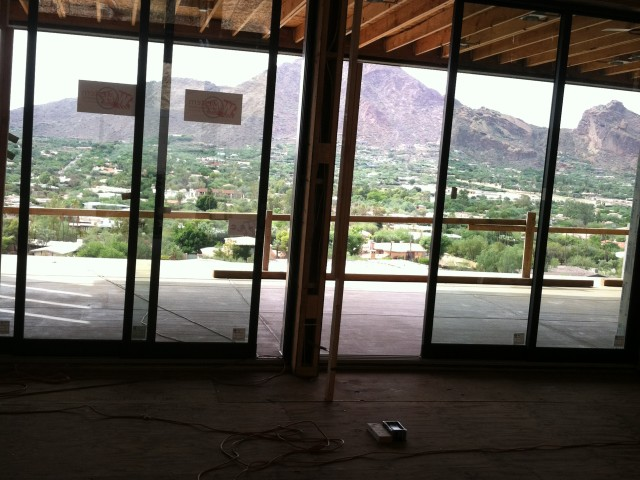 Expansive sliding glass doors lead out to a covered patio to enjoy the beautiful mountain views.
