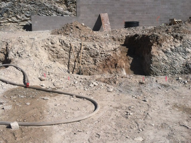 There will be about a three-foot elevation difference between the back yard and house.