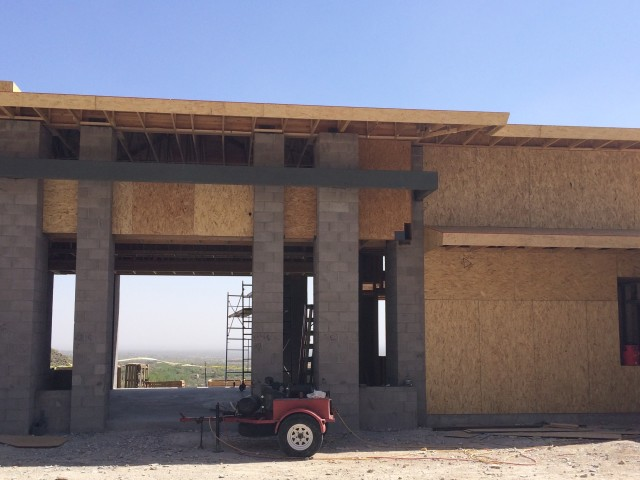 Masonry, wood, and steel framing allow this magnificent house to take shape.
