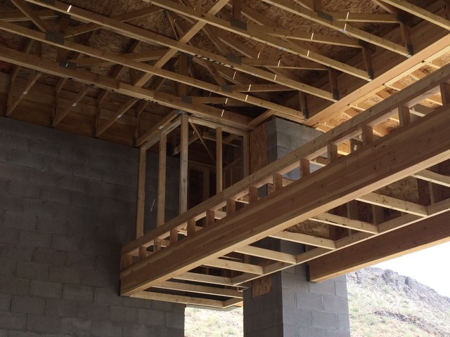 Wood trusses and framing combined with the masonry columns make the structure of this hillside home very sturdy.