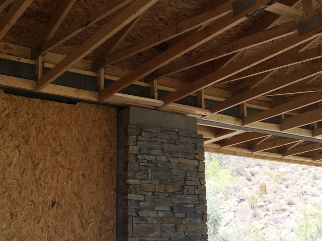 Stone is installed on masonry columns earlier than unusual in this home's process.