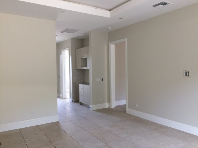 Spacious and comfortable, the guest house paint and flooring is finished.