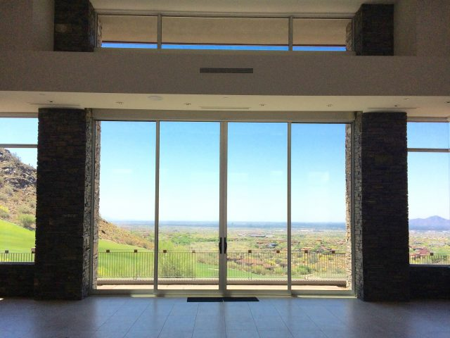 Glorious golf course and mountain views are seen from the floor-to-ceiling glass doors.