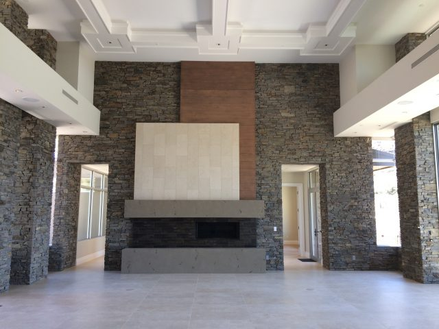 Elevated ceiling with beautiful detail sits atop the unique Great Room fireplace.