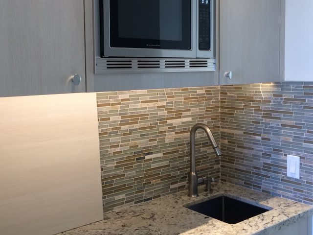 Convenient wet bar in the Guest House with sink, microwave and refrigerator.