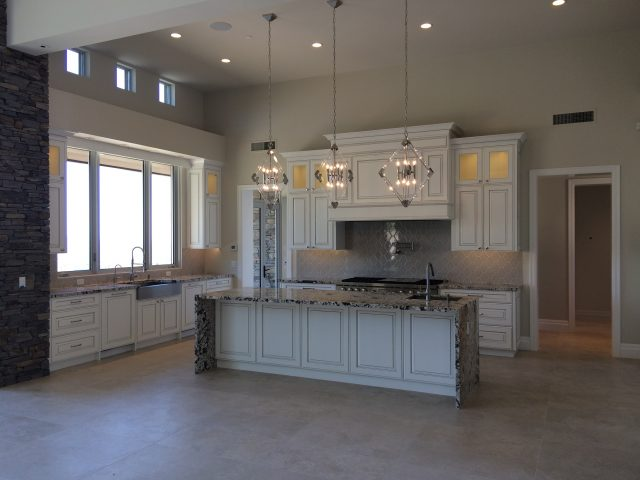 Beautiful white cabinetry goes will with the granite countertops.