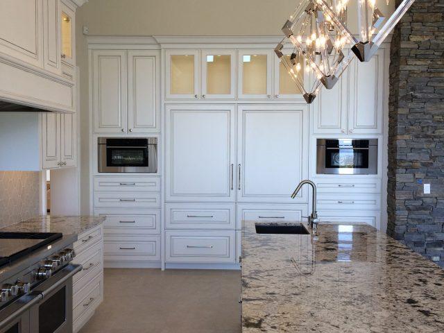Elegant lighting illuminates the Kitchen all the way across.