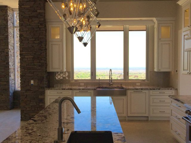 Natural light pours in through the large windows to wonderful golf course views.