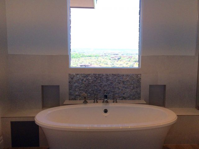 Strategically placed under a window for views and privacy simultaneously.